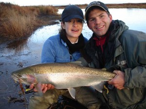 Brian and Serena Kraft holding A large Rainbow Trout