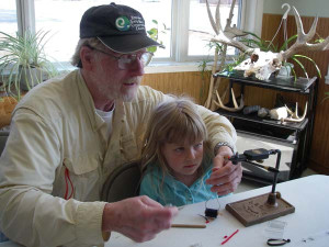 Jim Thibodeau Teaching Fly Tying To a Child