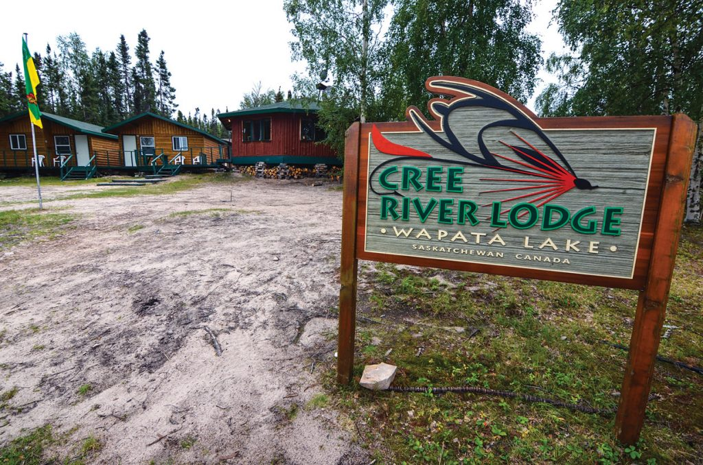 Cree River Lodge sign and cabins