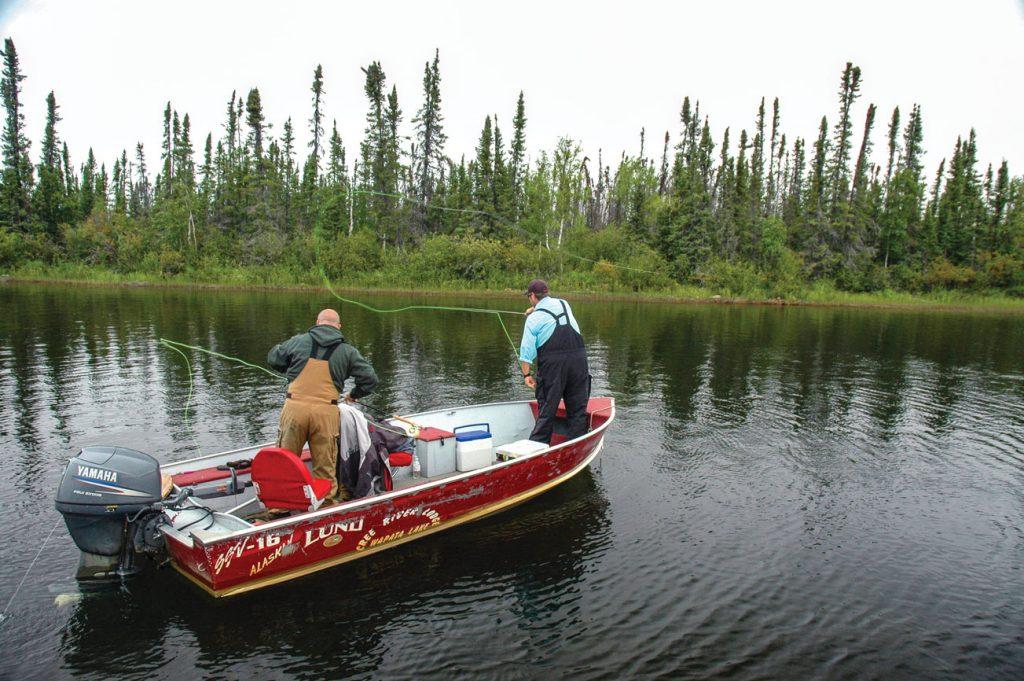 Men in boat fishing for pike in Saskatchewan